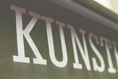 Kunst in letters on banner Stock Images