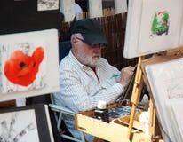 Kunstenaar die op Montmartre trekt Stock Afbeeldingen