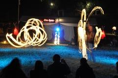 Kunstenaars die met brand op Festival Ozora spelen Stock Foto's