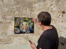 Kunstenaarsschilder op het terras Stock Fotografie