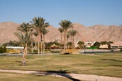 Kunstmatige oase bij het hotel. Taba, Egypte. Stock Afbeeldingen