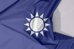 Kuomintang fabric flag crepe and crease with white space. A white Sun with twelve rays on blue background vector illustration