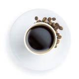 Kupa av kaffe med kaffebönor arkivfoto