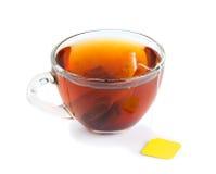 Kupa av tea med teabagen Royaltyfria Bilder