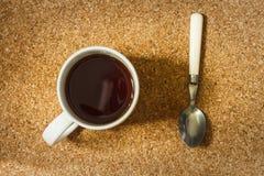 Kupa av tea och skeda Fotografering för Bildbyråer