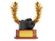 Kupa i form av förgrena sig och en kamera Arkivfoton
