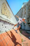 Man skating in abandoned building stock photos