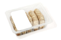 Kupaty (bratwursts) in modified atmosphere packaging (MAP). On the white background Royalty Free Stock Photos