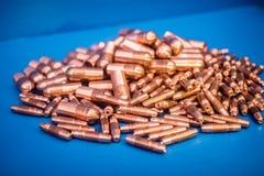 Kupfer, Kappentipps Stockfoto