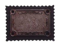 Kupferner schnitzender Hintergrund auf schwarzem Gewebe Stockbild