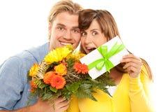 Kupon und Blumen lizenzfreie stockfotos