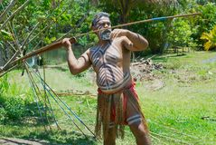 Aborigine actor throws a spear in the Tjapukai Culture Park in Kuranda, Queensland, Australia. Stock Photography