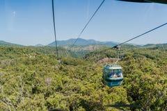 Forests Cable Car Passengers. Kuranda Mountain Forests Cable Car going over the tropical forests between Cairns and Kuranda in Queensland Australia Royalty Free Stock Photography