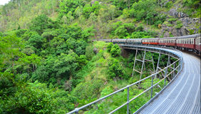 Kuranda Scenic Railway Rounding a bend in Queenland Australia. Kuranda Scenic Railway Rounding a bend on top of a bridge in the tropical north of Queensland royalty free stock image