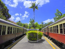 Two trains at Kuranda train station. Two tourist trains of the Kuranda Scenic Railway at Kuranda train station, Australia royalty free stock images