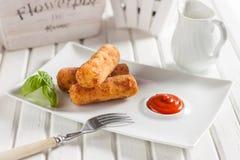 Kurczaków croquettes z serem na białym tle Obraz Royalty Free