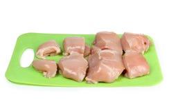 Kurczak i _ na zieleń deska Zdjęcia Stock