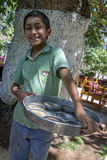 A Kurdish boy with fish food in Urfa. Royalty Free Stock Images