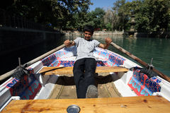 A Kurdish boys rows a boat in Urfa in Turkey. Royalty Free Stock Photo