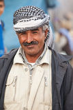 Kurdish man with traditional clothes smiling  to the camera Stock Photo