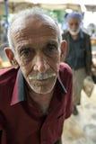 A Kurdish man in Urfa in Turkey. An old Kurdish man in the tea garden of the Urfa (Sanliurfa) bazaar in Urfa in south eastern Turkey Royalty Free Stock Photos