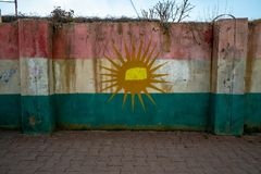 Kurdistan flag painted on a wall in Halabja, Iraq royalty free stock images