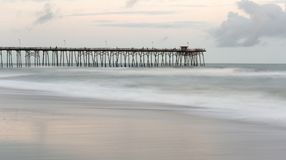 Kure Beach, North Carolina. Fishing pier and waves at Kure Beach, North Carolina Stock Photography