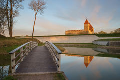 Kuressaare castle and bridge over the moat in beautiful sunrise Stock Photos
