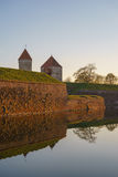 Kuressaare Episcopal castle and moat with water in sunset light Royalty Free Stock Photo