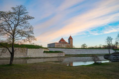 Kuressaare Episcopal Castle in morning dawn by springtime Royalty Free Stock Image
