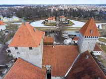 Kuressaare Fortress and guest houses on moat. Spring. Medieval fortification in Saaremaa island, Estonia, Europe Stock Images