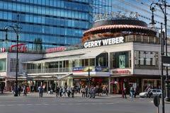 Kurfurstendamm, Berlin. BERLIN, GERMANY - AUGUST 27, 2014: People shop at famous Kurfurstendamm Ku`Damm Avenue in Berlin. Berlin is Germany`s largest city with Royalty Free Stock Photos