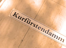 Kurfurstendamm street sign. Closeup of Kurfurstendamm street sign on shiny surface, Berlin, Germany Royalty Free Stock Images