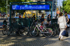 Kurfurstendamm U-Bahn exit in Berlin. Street view of an exit for Kurfurstendamm U-Bahn subway  Berlin with parked bicycles in the foreground and people walking Stock Image