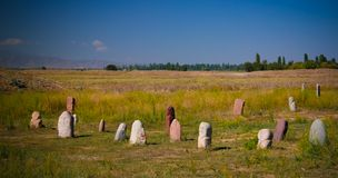 Kurgan stelae aka Balbals near the Berana tower, Tokmok,Chuy Valley Kyrgyzstan royalty free stock photography