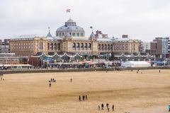 The Kurhaus along the boulevard with in front the beach of Scheveningen in the Netherlands royalty free stock photography