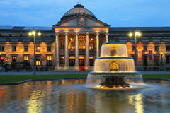 Kurhaus and Bowling Green in the evening with lights, Wiesbaden,. WIESBADEN, GERMANY-MAY 24: Kurhaus and Bowling Green in the evening with lights on May 24, 2017 stock photo