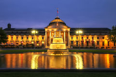 Kurhaus and Bowling Green in the evening with lights, Wiesbaden, Hesse, Germany. Wiesbaden is one of the oldest spa towns in Europe stock photos