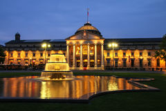 Kurhaus and Bowling Green in the evening with lights, Wiesbaden, Stock Images