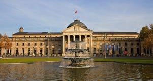 Kurhaus - Casino of Wiesbaden with fountain. Hessen, Germany royalty free stock photos