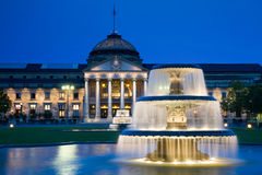 Kurhaus Wiesbaden at twilight. Kurhaus Wiesbaden with fountains at twilight, Hessen, Germany Royalty Free Stock Photo