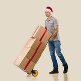 Kurier, handcart prezenta pudełka obraz stock