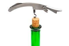 Kurketrekker, cork en fles Stock Foto