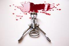 Kurketrekker in een bloedpool stock fotografie