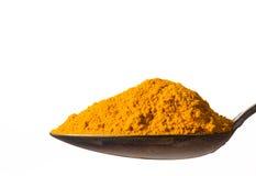 Kurkuma powder on spoon royalty free stock image