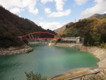 Kurobe Gorge, Hida Mountains, Japan. Red bridge and river at Kurobe Gorge Royalty Free Stock Photos
