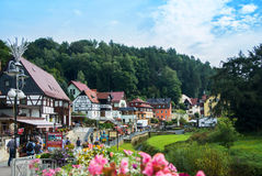 KURORT RATHEN, GERMANY - AUGUST 4, 2016: A view to Kurort Rathen houses, forest and Bastei mountains Royalty Free Stock Image