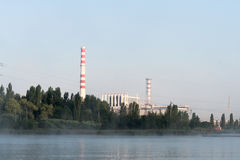 Kursk Nuclear Power Plant reflected in a calm water surface. Stock Photography