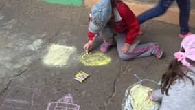 Kursk, Russia - June 1, 2017: children draw with crayons on the pavement.day of protection of children stock video