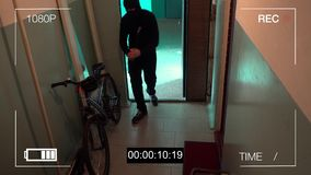 Kursk,Russia,June 30 : surveillance camera caught the thief broke the door and stole the bike stock video footage